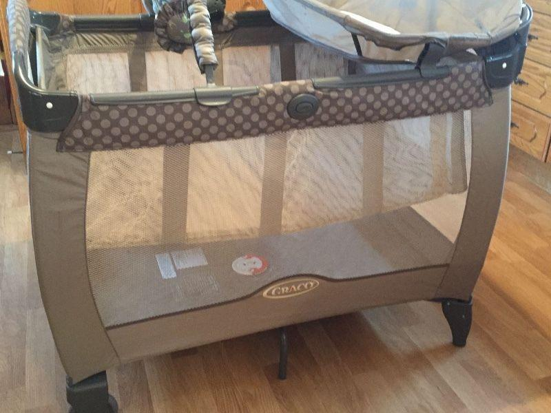 Bravo travel cot for sale