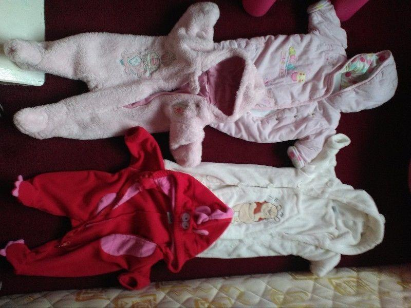 Baby stuff(footmuffs,buggy,clothes,swing,carrier,sling,blankets,cot divider,toys).Great condition