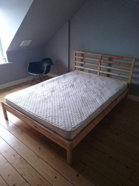 Slatted double bed with solid wood frame in excellent condition