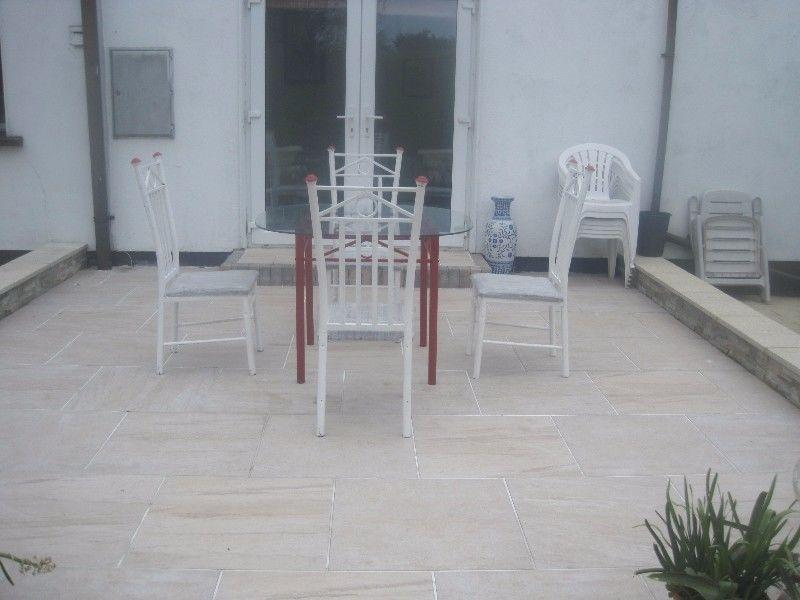 Patio Glass and Metal Table with 4 Matching Padded Chairs