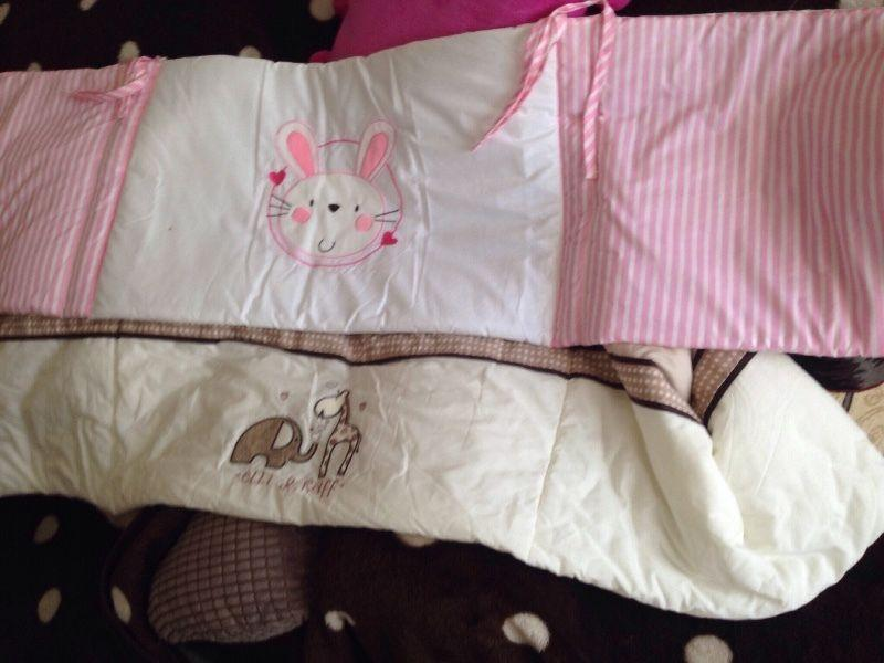 Two cot bumpers and baby sleep bag