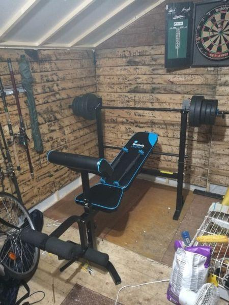 Folding weight bench with leg curl and preacher curl attachments - like new